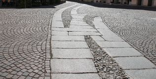 Ancient paving stones in historic centre of Piacenza Stock Photography