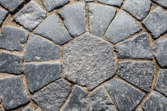 Ancient paving,. Texture and background. Pavers. Sidewalk street paved with cobblestones. Historic bridge in St. Petersburg Stock Photo