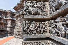 Ancient people and myth lions on old wall of temple. Old Indian artwork Stock Photo