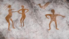 Ancient people painted on the wall of the cave ocher. Archeology Royalty Free Stock Photography