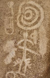 Ancient petroglyph with hunters figures Royalty Free Stock Images
