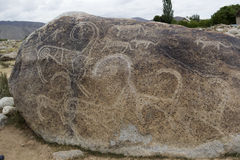 Ancient petroglyph located in Cholpon Ata, Issyk-Kul, Kyrgyzstan.  Stock Images