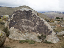 Ancient petroglyph located in Cholpon Ata, Issyk-Kul, Kyrgyzstan.  Stock Image