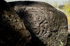 Ancient Petroglyph is located in the Sikhote-Alin , Khabarovsk, Russia. Ancient Petroglyph is located in the Sikhote-Alin , Khabarovskiy kray, Russia Stock Photos