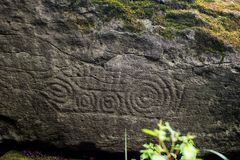 Ancient Petroglyph is located in the Sikhote-Alin , Khabarovsk, Russia. Ancient Petroglyph is located in the Sikhote-Alin , Khabarovskiy kray, Russia Royalty Free Stock Photography