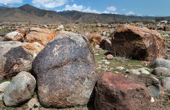 Ancient petroglyph on the stone. Dating from 8 th c BC - 5 th c. AN and located in Cholpon Ata, Issyk-Kul, Kyrgyzstan Stock Image