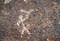 Ancient petroglyph on the stone. Dating from 8 th c BC - 5 th c. AN and located in Cholpon Ata, Issyk-Kul, Kyrgyzstan Royalty Free Stock Photo