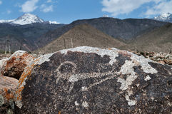 Ancient petroglyph on the stone. Dating from 8 th c BC - 5 th c. AN and located in Cholpon Ata, Issyk-Kul, Kyrgyzstan Stock Photography