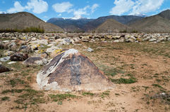 Ancient petroglyph on the stone. Dating from 8 th c BC - 5 th c. AN and located in Cholpon Ata, Issyk-Kul, Kyrgyzstan Royalty Free Stock Image