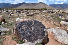 Ancient petroglyph on the stone. Dating from 8 th c BC - 5 th c. AN and located in Cholpon Ata, Issyk-Kul, Kyrgyzstan Stock Photo