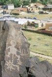 Ancient petroglyph and suburbs, Albuquerque, NM Stock Photos
