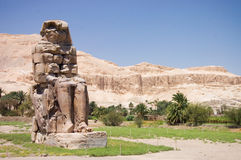 Ancient Pharaoh statue and column Stock Image