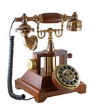 Ancient phone. Is photographed on the white background Royalty Free Stock Photo