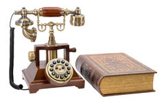 Ancient phone and  book Stock Photo