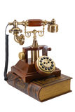 Ancient phone and book Royalty Free Stock Photos