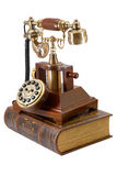 Ancient phone and book Royalty Free Stock Photo