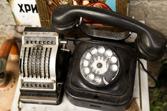 Ancient phone and computer. Items on sale in an antique shop Stock Images