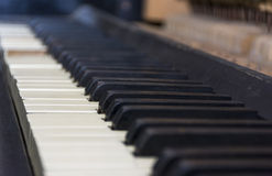 Ancient piano keys. Small depth of field Stock Images