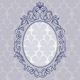 Ancient picture frame. Hanging on the wall with blue wallpaper Royalty Free Stock Photo