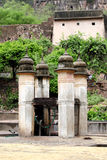 Ancient pillars on top of water tank with water lifting mechanism Stock Photography