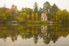 Ancient pink pavilion on autumn park lake Stock Photography