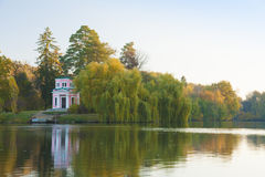 Ancient pink pavilion in autumn park lake Royalty Free Stock Photos