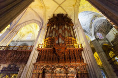 Ancient pipe organ in a cathedral in Seville Stock Image