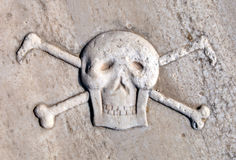 Ancient Pirate Skull and Crossbones. Royalty Free Stock Photo