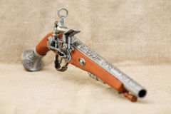 Ancient pistol on background canvas Royalty Free Stock Photography