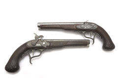 Ancient pistols. Duel pistols on a white background royalty free stock images