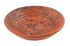 Ancient plate from ceramics. On a white background Stock Image