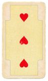 Ancient playing card with three red hearts Stock Photography