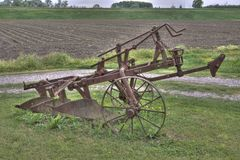 Ancient plough on the grass Royalty Free Stock Photo