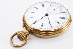 Ancient pocket watch in the bronze case Stock Photo