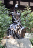 Ancient poet statue. Du Fu was a prominent Chinese poet of the Tang Dynasty. A metal sculpture of his Institute, Du Fu's Thatched Cottage Museum, Chengdu city stock photography