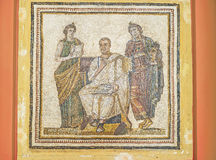 The ancient poet. TUNIS, TUNISIA - SEPTEMBER 2, 2015: The mosaic picture with Virgil, writing the Aeneid poem, inspired by the muses, Clio and Melpomene, Bardo Royalty Free Stock Images