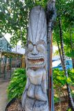 Ancient Polynesian style tiki wooden carvings in Waikiki beach stock image