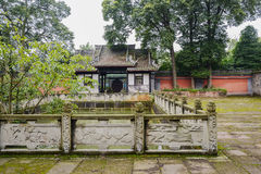 Ancient pond with stone balustrade in woody yard of Chinese buil Royalty Free Stock Photo