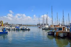 Ancient port and marina, old city of Acre, Israel. ACRE, ISRAEL - April 11, 2019: view on marina with yachts and fishing port in old city Acre, Israel royalty free stock image