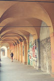 Ancient porticos in Bologna in Italy. Porticos on the background. Bologna, Italy Stock Photos