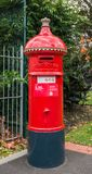 Ancient Post Box. In Melbourne, Australia the signs of the old British Empire can be found everywhere. This old post box would not look out of place in England Stock Photo