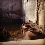 Ancient pots in one of the houses of Pompei royalty free stock images