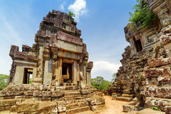 Ancient prang of Ta Keo temple. Angkor, Siem Reap, Cambodia. Ancient prang of mysterious Ta Keo temple in amazing Angkor, Siem Reap, Cambodia. Blue sky and woods Royalty Free Stock Images