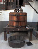 Ancient press for a grapes extraction Royalty Free Stock Image