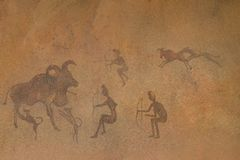 Ancient primitive drawings on cave walls. These drawings were painted by early human ancestors Stock Image