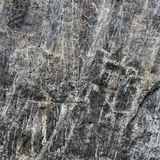 Ancient Primitive Rock Carvings on Black Stone Stock Photography