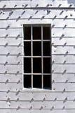 Ancient prison door with iron bars. Ancient metal prison door with iron bars stock photos