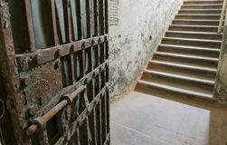Ancient prison door opening to steps, and way out Royalty Free Stock Photography