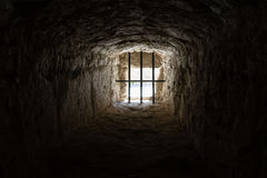 Ancient prison window. Ancient medieval prison window from the inside Royalty Free Stock Image