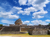 Ancient pyramid and the Maya observatory. View of the ancient pyramid and the Maya observatory against the background of clouds Stock Photo